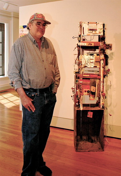 Joel Schapira: Artist standing with Contraption to Clear the Air
